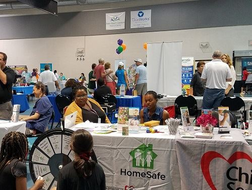 People visiting vendor booths at the Health, Wellness and Resource Fair.