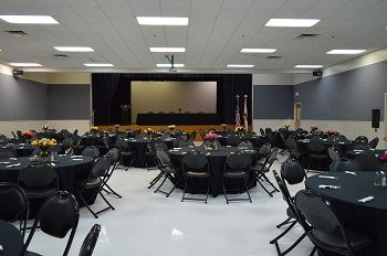 A large room with tables and chairs set up.