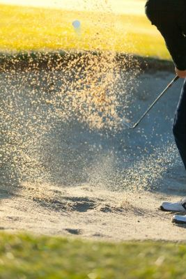 Golfer Hitting Ball Out of Sand Trap