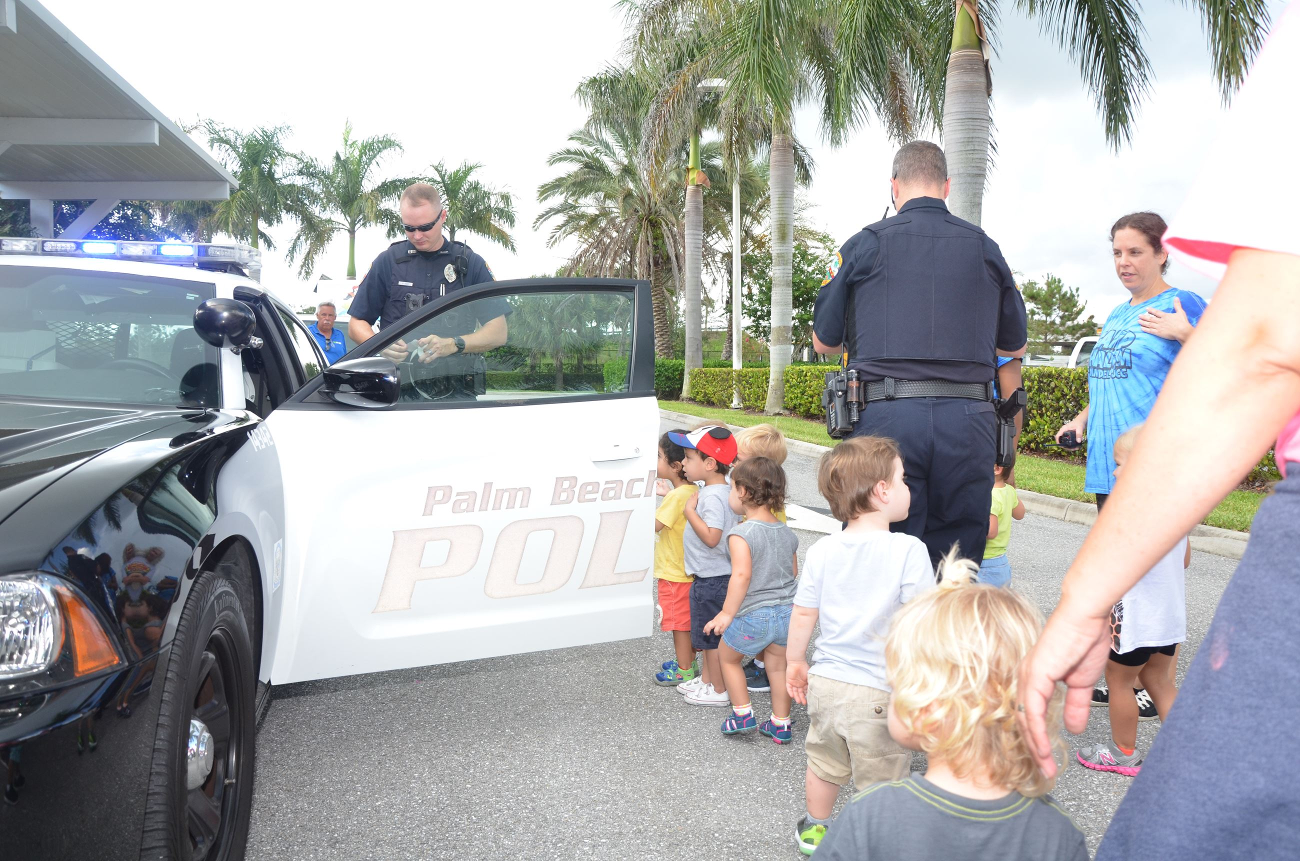 Police Officers Displaying Car to Children