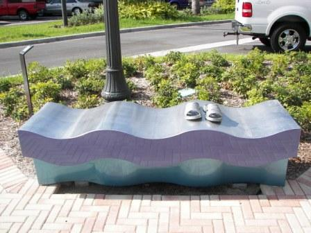 Indigo bench with wavy design and pair of shoes on bench
