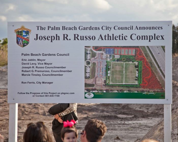 "A sign displaying ""Joseph R. Russo Athletic Complex"""